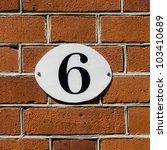 new house number six on an oval plate - stock photo