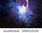 man's hands arc welding steel ... | Shutterstock . vector #1034115133