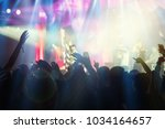concert crowd in silhouettes of ... | Shutterstock . vector #1034164657