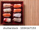 sushi tray japanese food flat... | Shutterstock . vector #1034167153