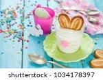 easter bunny ears mousse...   Shutterstock . vector #1034178397