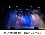 an empty stage of the theater ... | Shutterstock . vector #1034237413