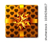 wrapped gift box with ribbon... | Shutterstock . vector #1034256817
