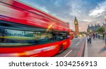 fast moving double decker bus... | Shutterstock . vector #1034256913