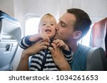 father and baby son during... | Shutterstock . vector #1034261653