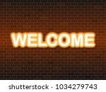 welcome text neon light   Shutterstock .eps vector #1034279743