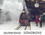 old locomotive stopped at the... | Shutterstock . vector #1034284243