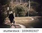 lonely old lady walking ... | Shutterstock . vector #1034302327