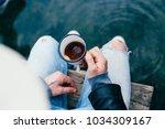over shoulder shot of trendy... | Shutterstock . vector #1034309167