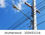 Street light against a blue sky background - stock photo