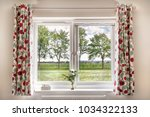 window with a view onto fields... | Shutterstock . vector #1034322133