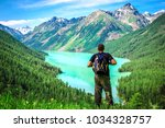 a young tourist enjoys the... | Shutterstock . vector #1034328757