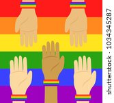 lgbt flag and hands with... | Shutterstock .eps vector #1034345287
