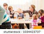 children are painting  | Shutterstock . vector #1034423737