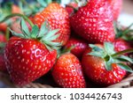 ripe strawberry in wooden... | Shutterstock . vector #1034426743