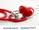 rendering stethoscope and red... | Shutterstock . vector #1034427577