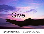 hand offering the word give ... | Shutterstock . vector #1034430733