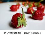 group of ripe strawberries on... | Shutterstock . vector #1034435017