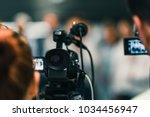 camera at media conference   Shutterstock . vector #1034456947