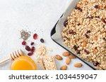 homemade granola ingredients... | Shutterstock . vector #1034459047