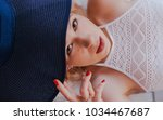 girl in bathing suit holding... | Shutterstock . vector #1034467687