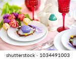 beautiful table setting with... | Shutterstock . vector #1034491003