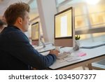 student in class working on...   Shutterstock . vector #1034507377