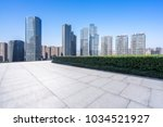 empty floor with modern building | Shutterstock . vector #1034521927