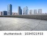 empty floor with modern building | Shutterstock . vector #1034521933