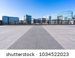 empty floor with modern building | Shutterstock . vector #1034522023