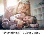 mother and daughter having fun...   Shutterstock . vector #1034524057