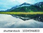 serenity lake in alaskan tundra | Shutterstock . vector #1034546803