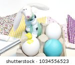 painting eggs and preparing a...   Shutterstock . vector #1034556523