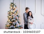 charming young couple hugs  in...   Shutterstock . vector #1034603107