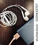 white earphone and power bank... | Shutterstock . vector #1034633707