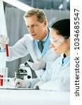 laboratory research. scientists ... | Shutterstock . vector #1034685547
