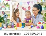 happy holiday  a mother and her ...   Shutterstock . vector #1034691043