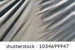 sunshine on the black fabric  ...   Shutterstock . vector #1034699947