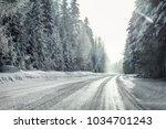view from a car riding through... | Shutterstock . vector #1034701243