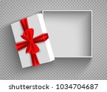 open gift box with red bow...   Shutterstock .eps vector #1034704687