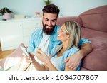 modern young couple enjoying at ... | Shutterstock . vector #1034707807