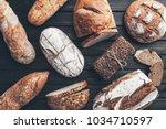 delicious freshly baked bread... | Shutterstock . vector #1034710597