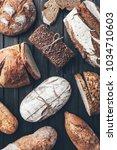 delicious freshly baked bread... | Shutterstock . vector #1034710603