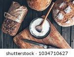 delicious freshly baked bread... | Shutterstock . vector #1034710627
