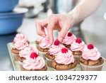 women in pastry bakery working... | Shutterstock . vector #1034729377