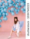 a beautiful  tender young girl...   Shutterstock . vector #1034760223