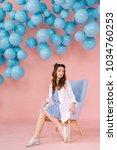 a beautiful  tender young girl...   Shutterstock . vector #1034760253