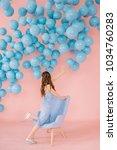 a sexy little girl in a blue...   Shutterstock . vector #1034760283