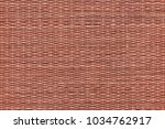 maroon red dyed plaited... | Shutterstock . vector #1034762917