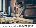 handsome concentrated... | Shutterstock . vector #1034775157